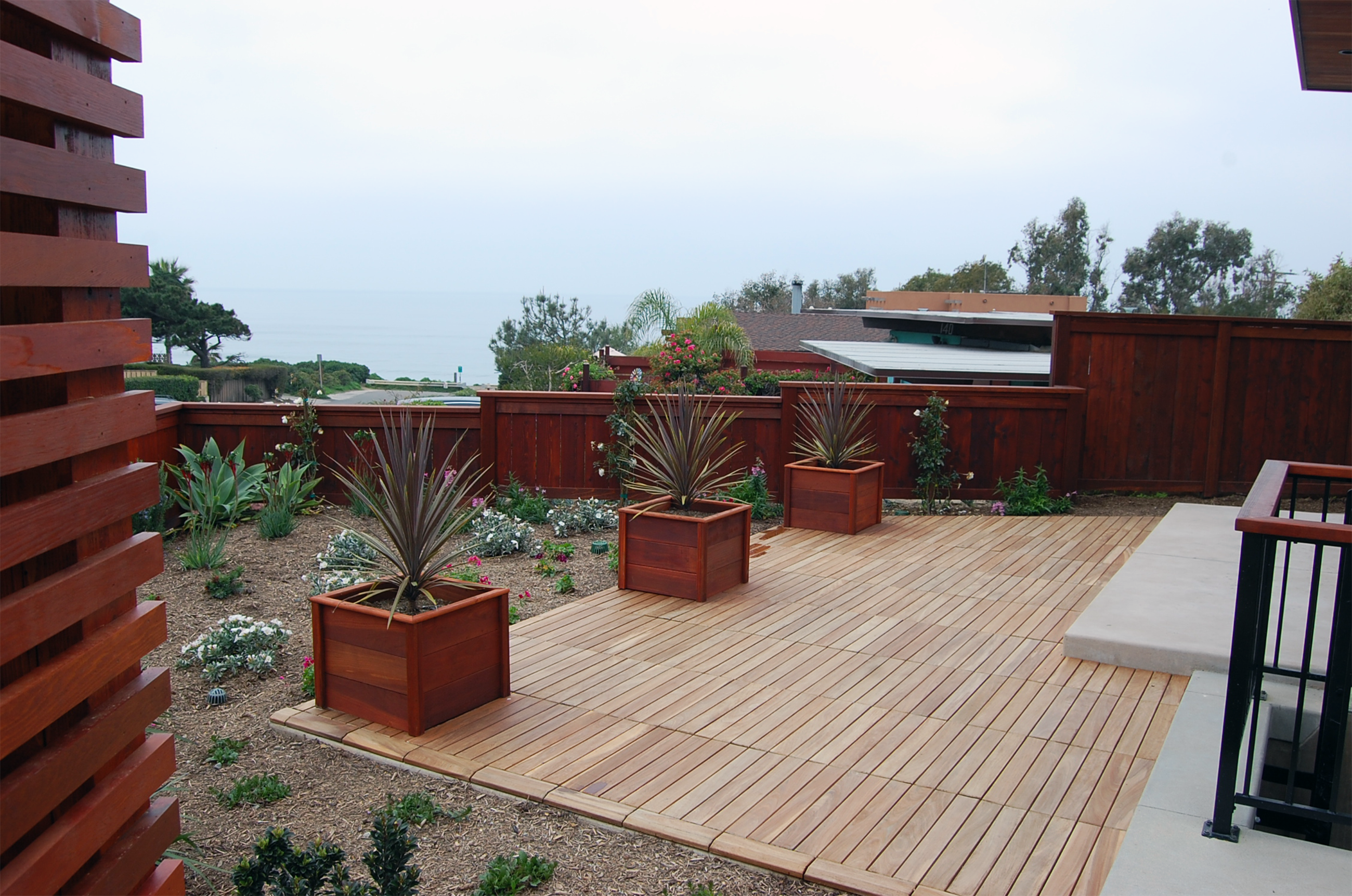 Designapplause ipe deck tile eco arbor designs for Outside decking material